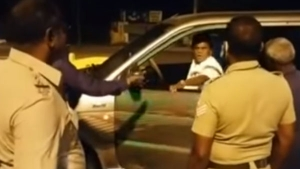 విధి నిర్వహణలో ఉన్న పోలీసును తన్నిన మాజీ MP, ఎవరో తెలుసా ?